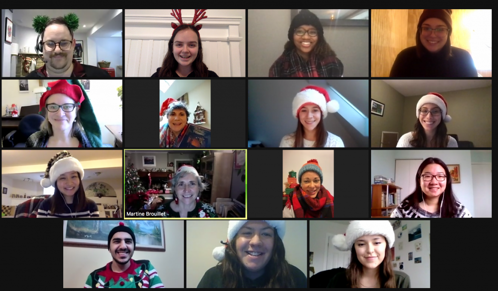 Screenshot of 5 of our staff members connecting via video chat. All are wearing Santa, elf, or winter hats.